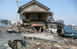Wreckage of a house in the aftermath of the 2011 Great East Japan Earthquake and Tsunami, in Ishinomaki City. PHOTO: Ishinomaki City/ The Archive of the Great East Earthquake in Miyagi