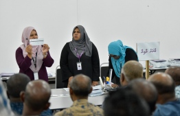 Polling officials recounting ballot papers for Baarah constituency. PHOTO: HUSSAIN WAHEED/ MIHAARU