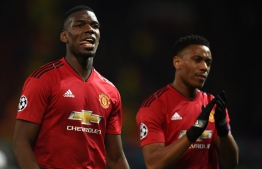 Manchester United's French midfielder Paul Pogba (L) and Manchester United's French forward Anthony Martial applaud fans after losing the UEFA Champions league first leg quarter-final football match between Manchester United and Barcelona at Old Trafford in Manchester, north west England, on April 10, 2019. (Photo by Oli SCARFF / AFP)