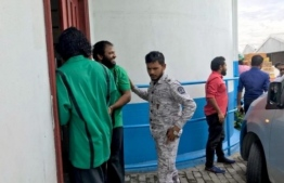 Ishaaq Ali of Maduvvari, Raa Atoll, and Hussain Afeef of Fuvahmulah arrive at the Criminal Court for their terrorism trial. FILE PHOTO: MIHAARU