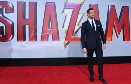 "(FILES) In this file photo taken on March 28, 2019 actor Zachary Levi arrives for the world premiere of ""Shazam!"" at the TCL Chinese theatre in Hollywood. - Warner Bros.' lighthearted superhero tale ""Shazam!"" held on to top spot on its second weekend, taking an estimated $25.1 million as it kept a flurry of newcomers at bay, industry watcher Exhibitor Relations said April 14, 2019. The family-friendly flick stars Asher Angel as Billy Baston, an unhappy foster kid who is transformed into a muscular, wise-cracking adult superhero (Zachary Levi) when anyone pronounces the secret word. (Photo by VALERIE MACON / AFP)"
