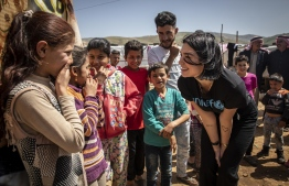 UNICEF supporter and singer/songwriter Dua Lipa visits children in an informal settlement near Terbol in the Bekaa Valley, Lebanon, April 13, 2019. PHOTO: UNICEF