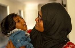Kayban Jamshaad with his mother. PHOTO/ABC NEWS