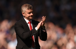 Manchester United's Norwegian manager Ole Gunnar Solskjaer applauds the fans after the final whistle in the English Premier League football match between Everton and Manchester United at Goodison Park in Liverpool, north-west England on April 21, 2019. (Photo by Oli SCARFF / AFP) /