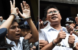 (FILES) This file combination of photos taken on September 3, 2018 shows journalists Kyaw Soe Oo (L) and Wa Lone being escorted by police after their sentencing by a court to jail in Yangon. - Myanmar's Supreme Court on April 23, 2019 rejected an appeal by two Reuters journalists jailed for seven years on charges linked to their reporting on the Rohingya crisis, a defence lawyer confirmed. (Photo by Ye Aung THU / AFP)