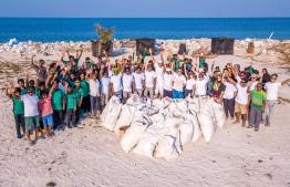 Volunteers mark the end of a beach clean-up. PHOTO/ANGSANA VELAVARU