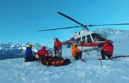 This handout photograph obtained courtesy of Parks Canada shows rescue operations for three missing moutaineers on April 21, 2019 in Banff National Park, Canada. - The bodies of three world-renowned professional mountaineers -- two Austrians and an American -- were found Sunday, April 21,2019 after they went missing during an avalanche on a western Canadian summit, the national parks agency said. American Jess Roskelley, 36, and Hansjorg Auer, 35, and David Lama, 28, of Austria went missing late Tuesday, April 16, 2019 attempting to climb the east face of Howse Peak at Banff National Park. Authorities launched an aerial search the next day. The three men were attempting to climb the east face of Howse Pass, an isolated and highly difficult route. (Photo by Handout / PARKS CANADA / AFP) /