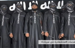 "An image grab taken from a press release issued on April 23, 2019 by the Islamic State (IS) group's propaganda agency Amaq, allegedly shows eight men it said carried out a string of deadly suicide bomb blasts on Easter Sunday in Sri Lanka, lined up at an undisclosed location. The man in the centre is belived to be Zahran Hashmi, who was identified by the Sri Lankan police as the leader of the Islamist National Thowheeth Jama'ath (NTJ) group, which Colombo has blamed for the attacks. - The Islamic State group claimed a series of bombings on churches and luxury hotels in Sri Lanka that killed more than 320 people on April 21, and released the photo of the men it said were behind the ""blessed attack"", describing them as ""fighters"" from the terror network. The massive casualty toll would make the Easter attacks the deadliest overseas operation claimed by IS since the group proclaimed its worldwide caliphate in mid-2014. PHOTO: HO / AAMAQ NEWS AGENCY / AFP"