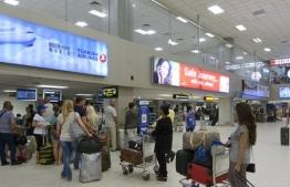 Travellers queuing at Bandaranaike International Airport in Sri Lanka.