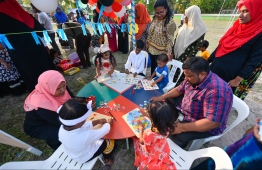 Children taking part in an education stall at the festival hosted at Thulusdhoo's football ground. PHOTO:  HUSSAIN WAHEED / MIHAARU