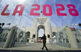 (FILES) In this file photo taken on September 13, 2017, the torch is lit at the Los Angeles Coliseum as the city was officially named as host of the 2028 Summer Olympics. - Los Angeles 2028 Olympics chiefs on April 30, 2019, unveiled details of the $6.9 billion budget for the Games, vowing to deliver the spectacle without cost overruns that have dogged recent editions of the extravaganza. A statement from LA 2028 said the city's Olympic plan, which relies entirely on pre-existing venues and infrastructure, included a 10 percent contingency fund of $615.9 million. (Photo by FREDERIC J. BROWN / AFP)