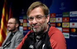 Liverpool's German coach Jurgen Klopp smiles during a press conference at the Camp Nou Stadium in Barcelona on April 30, 2019 on the eve of the UEFA Champions League semi-final first leg football match between Barcelona and Liverpool. (Photo by Josep LAGO / AFP)