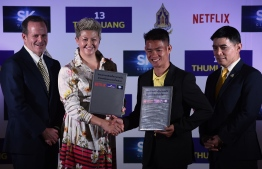 (From L to R) SK Global Entertainment/Ivanhoe Pictures president of international productions Michael Hogan, Netflix director of international originals Erika North, 'Wild Boars' football team coach Ekkapol Chantawong and Thai army Lieutenant-General Werachon Sukondhapatipak pose during a press conference in Bangkok on April 30, 2019 regarding a Netflix series about the rescue of the team from the Tham Luang cave. The 12 boys and their football team coach became trapped in a flash flood inside Tham Luang cave on June 23, 2018, 4km away from the cave's entrance. An international effort supported Thai Navy SEALs in the rescue mission. PHOTO/AFP