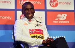 Men's elite race winner Kenya's Eliud Kipchoge attends the London Marathon winners' press conferece at Tower Bridge in central London on April 29, 2019. (Photo by Ben STANSALL / AFP)