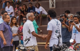 President Ibrahim Mohamed Solih (C-L) seen shaking hands with Maldives Surfing Association's Chairman Mohamed Sobah (C-R). PHOTO: MALDIVES SURFING ASSOCIATION / FACEBOOK
