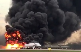 This handout grab of a video obtained from the Instagram account of Gunkevitch on May 5, 2019, shows a fire of a Russian-made Superjet-100 at Sheremetyevo airport outside Moscow. - The Interfax agency reported that the plane, a Russian-made Superjet-100, had just taken off from Sheremetyevo airport on a domestic route when the crew issued a distress signal. 13 person died according to Russian agencies. (Photo by HO / INSTAGRAM / AFP) /