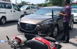 Minister of Housing and Urban Development Ahmed Athifa's official car and the motorcycle that collided into it. No one was injured during the accident. PHOTO: MIHAARU FILES