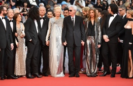 "(From L) Producer Carter Logan, US cinematographer Frederick Elmes, guest, US actor Luka Sabbat, US actor and comedian Bill Murray, British actress and model Tilda Swinton, US film director, screenwriter and actor Jim Jarmusch, his partner US actress and film director Sara Driver, US actor Adam Driver and US film actress Chloe Sevigny pose as they arrive for the screening of the film ""The Dead Don't Die"" during the 72nd edition of the Cannes Film Festival in Cannes, southern France, on May 14, 2019. (Photo by LOIC VENANCE / AFP)"