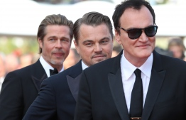 """(FromR) US film director Quentin Tarantino, US actor Leonardo DiCaprio and US actor Brad Pitt arrive for the screening of the film """"Once Upon a Time... in Hollywood"""" at the 72nd edition of the Cannes Film Festival in Cannes, southern France, on May 21, 2019. (Photo by Valery HACHE / AFP)"""