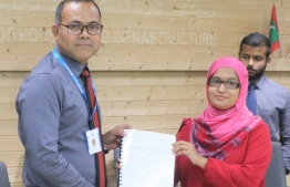 MTCC CEO Hassan Shah signs agreement with Director General of Ministry of National Planning and Infrastructure Fathimath Shana Farooq. PHOTO: MINISTRY OF NATIONAL PLANNING AND INFRASTRUCTURE.