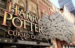 """A sign for """"Harry Potter and the Cursed Child"""" hangs at the Broadway opening at the Lyric Theatre on April 22, 2018 in New York City. PHOTO/Evan Agostini/Invision/AP"""
