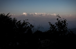 (FILES) This file photo taken on November 13, 2015, shows a general view of the Himalayas from the hill-station of Kausani in the northern Indian state of Uttarakhand. - Scores of emergency workers were battling bad weather Saturday to locate eight climbers missing on India's second highest mountain, an official said. Four Britons, two Americans, an Australian and an Indian were set to climb the 7,826-metre (25,643-foot) Nanda Devi East peak -- near the border with China -- and return to the base camp last weekend. (Photo by Agnes BUN / AFP)