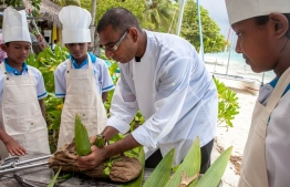 Sobah demonstrating how to prepare meals in a cooking class held for young enthusiasts in Soneva Fushi. PHOTO: MIHAARU