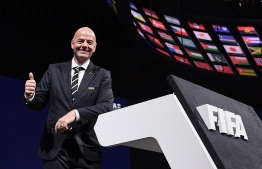 FIFA President Gianni Infantino poses for a picture after being re-elected by acclamation for a second term at the 69th FIFA Congress at Paris Expo, Porte de Versailles in Paris on June 5, 2019 - The 49 year-old, who took charge of FIFA in February 2016 after the departure of the disgraced Sepp Blatter, stood unopposed for re-election for a new four-year term which will run until 2023. (Photo by FRANCK FIFE / AFP)
