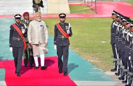 Indian Prime Minister Narendra Modi inspects the guard of honour at the Republic Square. A 21-gun salute was offered to PM Modi during his visit. PHOTO: HUSSAIN WAHEED / MIHAARU