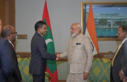 Vice President Faisal Naseem (L) greets Indian Prime Minister Narendra Modi, during the latter's first state visit to Maldives on June 8, 2019. PHOTO/PRESIDENT'S OFFICE