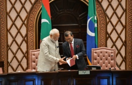 Parliament Speaker Mohamed Nasheed (L) presents the first Constitution of the Maldives to Indian Prime Minister Narendra Modi during the former's first state visit to Maldives on June 8, 2019. PHOTO: HUSSAIN WAHEED/MIHAARU