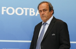 (FILES) In this file photo taken on August 28, 2015 UEFA chief Michel Platini arrives for a UEFA press conference after the draw for the UEFA Europa League football group stage 2015/16 in Monaco. - Ex-UEFA chief Michel Platini was arrested on June 18, 2019 in connection with a probe into the awarding of the 2022 World Cup to Qatar, a source close to the investigation said. PHOTO: VALERY HACHE / AFP