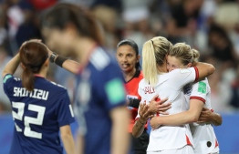 England's forward Ellen White (R) celebrates after scoring her second goal during the France 2019 Women's World Cup Group D football match between Japan and England, on June 19, 2019, at the Nice Stadium in Nice, southeastern France. (Photo by Valery HACHE / AFP)