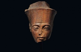 An undated handout picture released by the auction house Christie's in London on June 26, 2019, shows a 3,000-year-old stone bust of Tutankhamun, set to be auctioned on July 4. Christie's this week will auction a 3,000-year-old stone bust of Tutankhamun — the Egyptian pharaoh most simply call King Tut -- at the heart of a diplomatic tug-of-war with Cairo. The French-owned British auction house expects the 28.5-centimetre (11-inch tall) brown quartzite relic from the Valley of the Kings to fetch more than £4 million ($5.1 million, 4.5 million euros) in London on Thursday. But Egyptian authorities overseeing the north African country's unparallelled collection of antiquities want the sale halted and the art treasure returned. HO / AFP / CHRISTIE'S AUCTION HOUSE