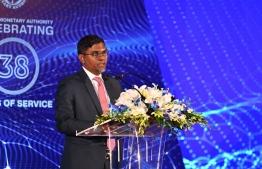 Governor of Maldives Monetary Authority (MMA) speaking at MMA's anniversary ceremony. PHOTO: HUSSAIN WAHEED/ MIHAARU