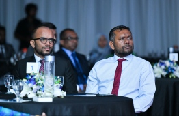 Finance Minister Ibrahim Ameer (L) and Economic Minister Fayyaz Ismail attend the Maldives Monetary Authority (MMA)'s 38th anniversary celebration ceremony in 2019. FILE PHOTO: HUSSAIN WAHEED / MIHAARU