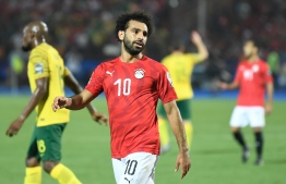 Egypt's forward Mohamed Salah reacts after conceding during the 2019 Africa Cup of Nations (CAN) Round of 16 football match between Egypt and South Africa at the Cairo International Stadium in the Egyptian Capital on July 6, 2019. (Photo by Khaled DESOUKI / AFP)