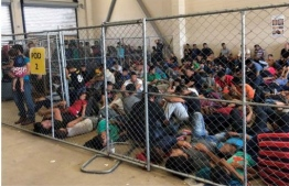"""This image released in a report on July 02, 2019 by the US Department of Homeland Security (DHS) Inspector General Office (OIG) shows migrant families overcrowding a Border Patrol facility on June 10, 2019 in McAllen, texas. - The report by the DHS inspector general said the health and security of both migrants and US Customs and Border Protection (CBP) officials is under threat """"We are concerned that overcrowding and prolonged detention represent an immediate risk to the health and safety of DHS agents and officers, and to those detained. """" (Photo by - / DHS/ Office of the Inspector General / AFP) /"""