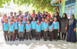 Maaenboodhoo School students posing for a picture near the library. PHOTO: BML