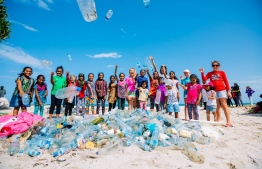 A beach clean-up in Maldives. Plastic bottles litter every beach in the country. PHOTO: SONEVA