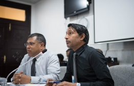 BML's Deputy CEO Mohamed Shareef (R) speaks at the meeting with the parliamentary Committee on Public Finance regarding the bank's alleged involvement in the MMPRC scandal. PHOTO/MAJILIS