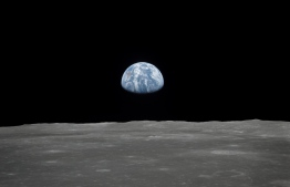 This July 1969 NASA file photo obtained July 16, 2019 shows a file view of Earth rising over the Moon's horizon taken from the Apollo 11 spacecraft. - NASA revealed its latest plan to return astronauts to the Moon in 2024 would cost $28 billion. (Photo by HO / NASA / AFP) /