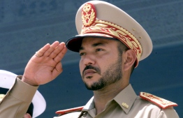 (FILES) In this file photo taken on July 31, 2000 Morocco's King Mohammed VI salutes in his capacity as army chief of staff at an official oath-taking ceremony of soldiers at the Royal Palace in Rabat. - Morocco's King Mohammed VI has cast himself as a modernist open to change, while discretely exercising absolute power from the throne he inherited 20 years ago. He has often presented that duality in photo ops, posing for official pictures in traditional garb then switching to snazzy suits for social media snapshots with celebrities during his frequent trips abroad. Born on August 21, 1963, Mohammed VI was crowned at the age of 35 after the death of his father Hassan II on July 23, 1999. (Photo by JOELLE VASSORT / AFP)