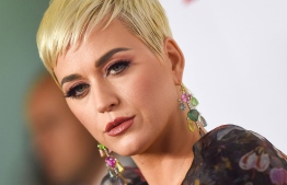 """(FILES) In this file photo taken on February 08, 2019 US singer Katy Perry arrives for the 2019 MusiCares Person Of The Year gala at the Los Angeles Convention Center in Los Angeles. - US singer Katy Perry plagiarized the beat of her 2013 hit """"Dark Horse"""" from a Christian rap song, a Los Angeles jury found Monday July 29, 2019. (Photo by Valerie MACON / AFP)"""