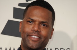(FILES) In this file photo taken on February 08, 2015 A. J. Calloway arrives on the red carpet for the 57th Annual Grammy Awards in Los Angeles. - Warner Bros has severed ties with US television host A.J. Calloway following an investigation into sexual assault allegations, the studio said Thursday. (Photo by Valerie MACON / AFP)