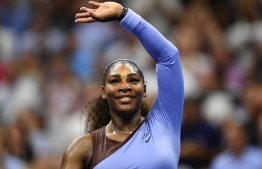 (FILES) In this file photo taken on September 06, 2018, Serena Williams of the US celebrates her victory against Anastasija Sevastova of Latvia during their 2018 US Open women's singles semi-finals match in New York. - Williams topped Forbes magazine's list of the highest paid women in sports for the fourth straight year on August 6, 2019. The business publication calculated that the 23-time Grand Slam singles champion earned $29.2 million in the 12-month period ending June 1 -- with just $4.2 million of that coming from prize money. (Photo by Don EMMERT / AFP)