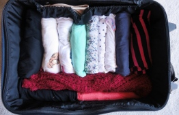 Rolling your clothes instead of folding can save a lot of space. PHOTO: GOOGLE