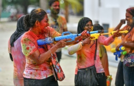 Participants of 'Fen Kulhi' attacking with water guns - it is impossible not to have a smile on your face when you are having this much fun. PHOTO: NISHAN ALI/ MIHAARU