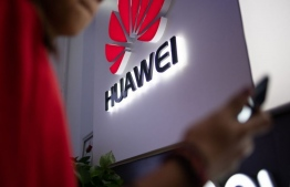 In this photo taken on May 27, 2019, a Huawei logo is displayed at a retail store in Beijing. (Photo by FRED DUFOUR / AFP/Getty Images)