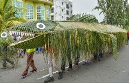 The traditional 'Bodu Mas' (translated directly into big fish), woven from palm leaves, being paraded on Hulhumale' streets. In most islands, 'Bodu Mas' is a dramatic performance depicting how a group of fishermen attempt to catch the fish. PHOTO: NISHAN ALI/ MIHAARU